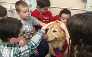 Munson Elementary students with Rosie the Therapy Dog - 2019-20 school year