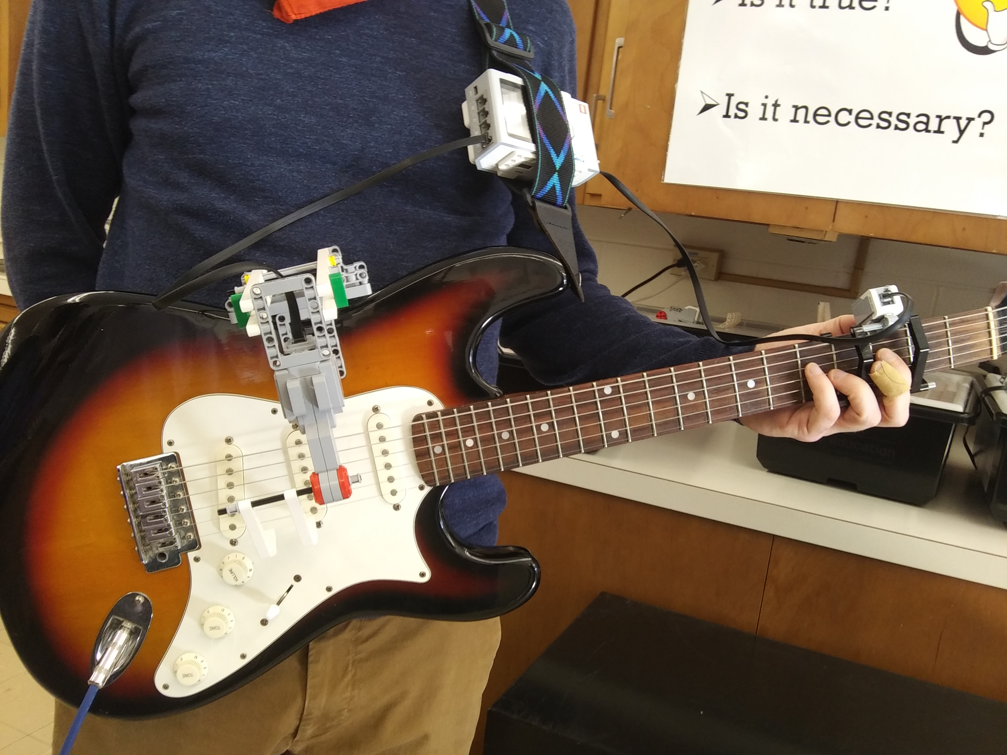 Mr. Brent Hilston Demonstrating StudentsCraig Chapman and Jared Luoma's Engineered One-Handed Guitar