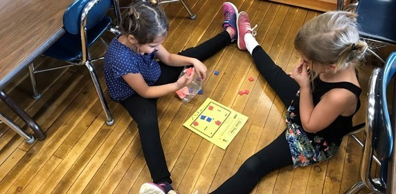 Working with a partner on Math games in extra fun!