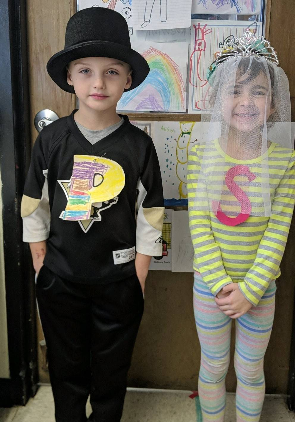 "Students dressed as ""P"" and ""S"" in the ""Q"" Marries ""U"" Wedding Event"