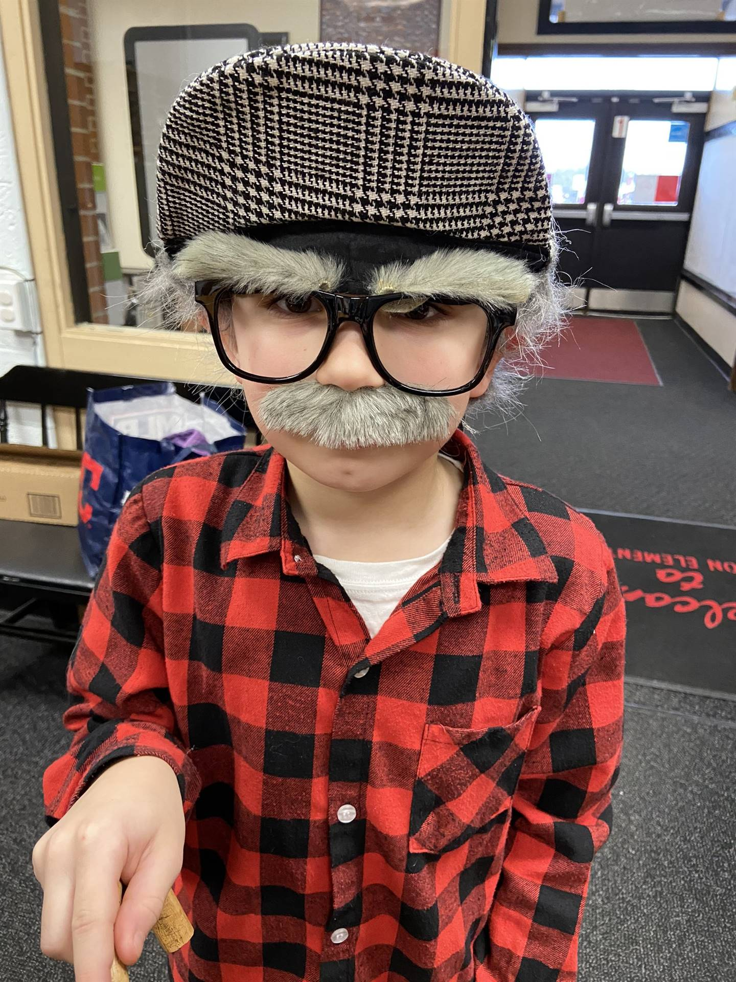 Student dressed as a 100-year old on the 100th Day of School