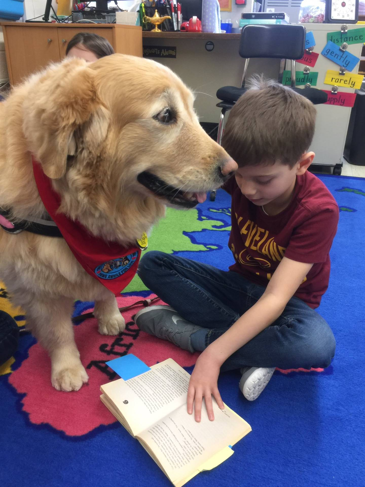 Munson Elementary - Student Reading to Therapy Dog