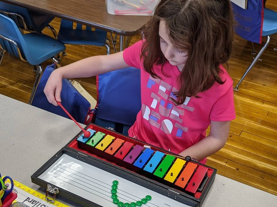 Park Elementary - Student Engaged with Xylophone during Music Class