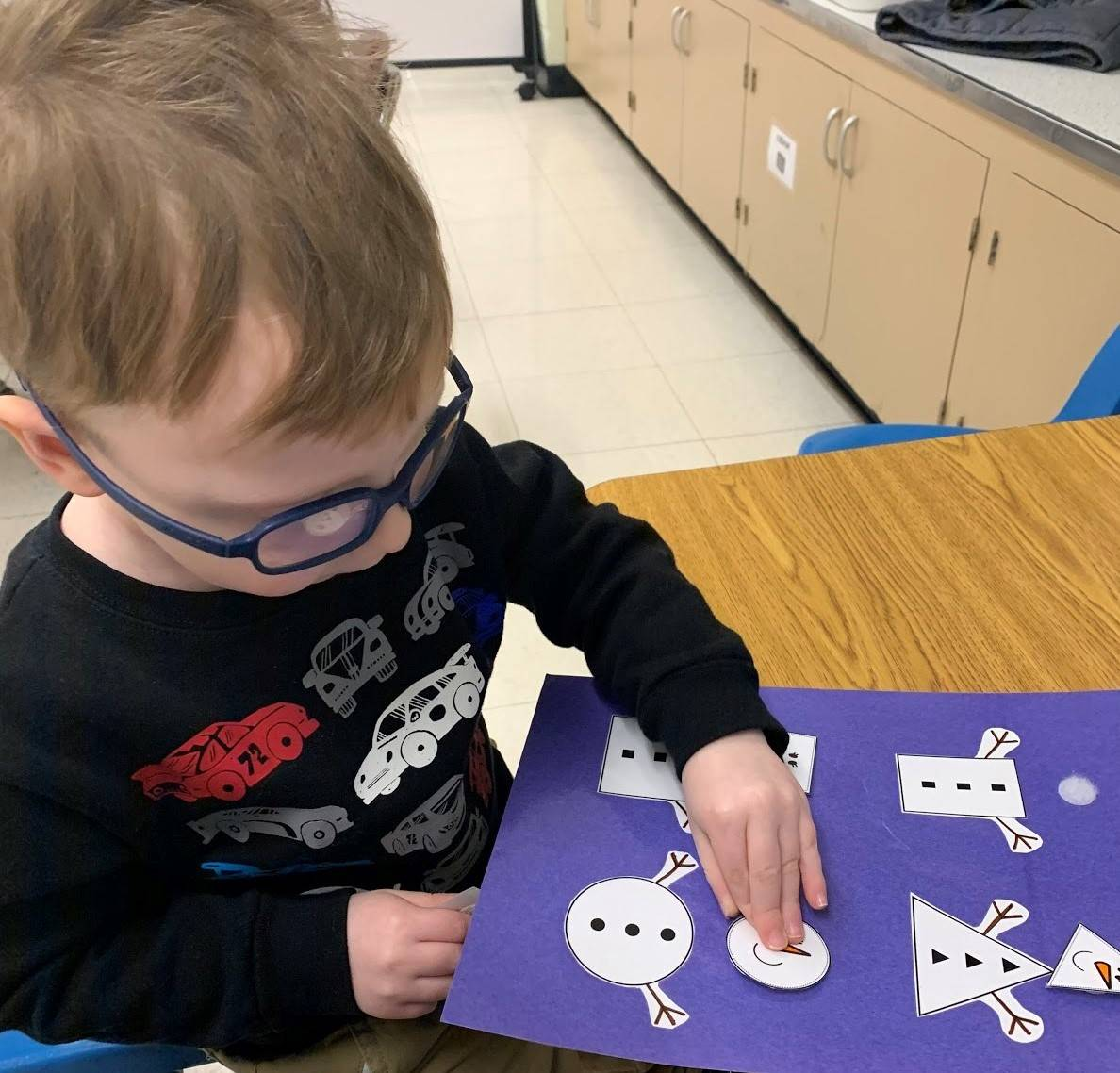 Tiny Toppers Student Engaged in Matching Activity