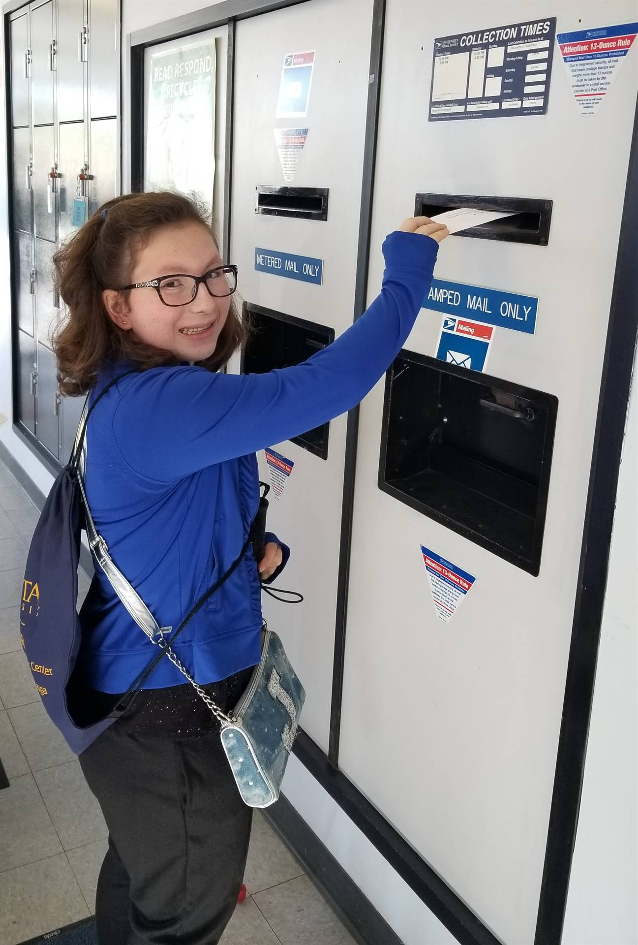CHS student engaged in field trip to the post office.
