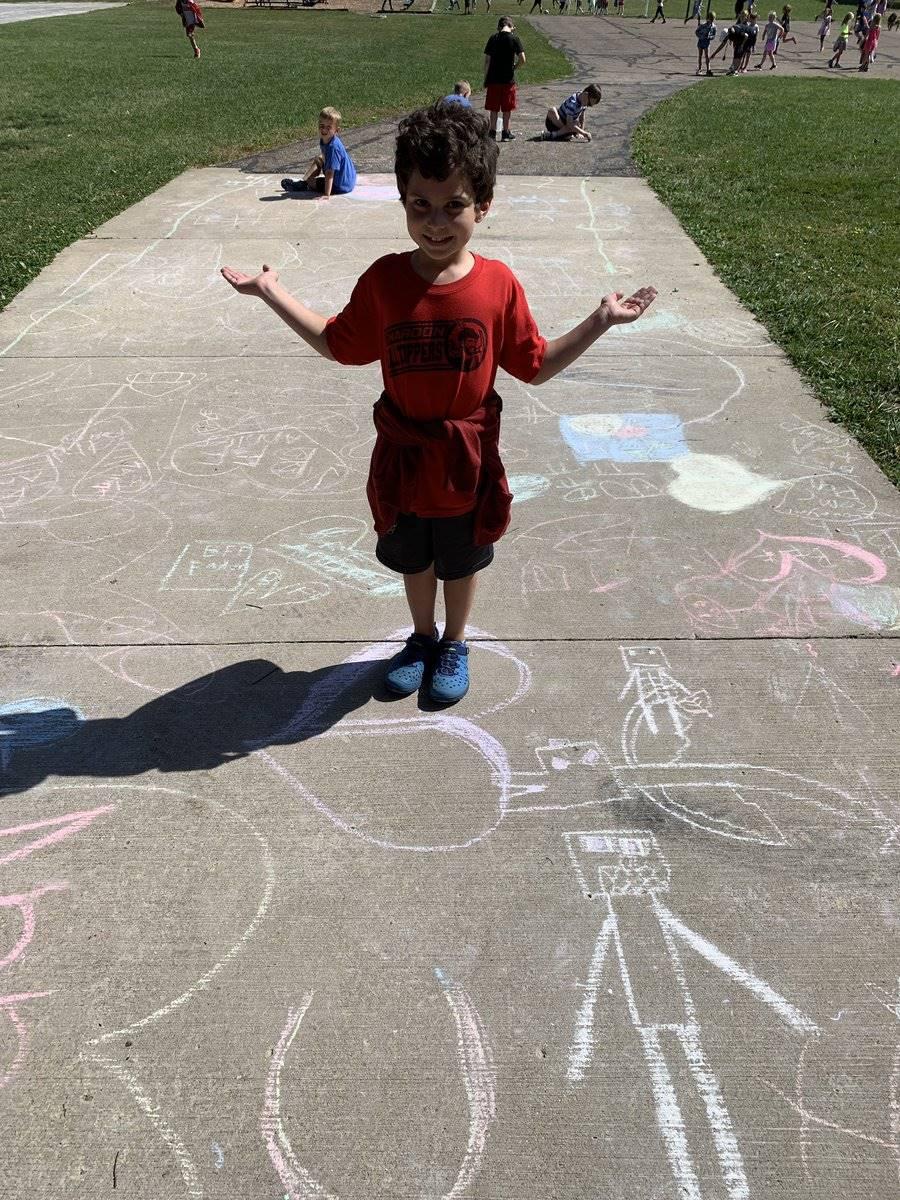 Munson Elementary student playing outdoors.
