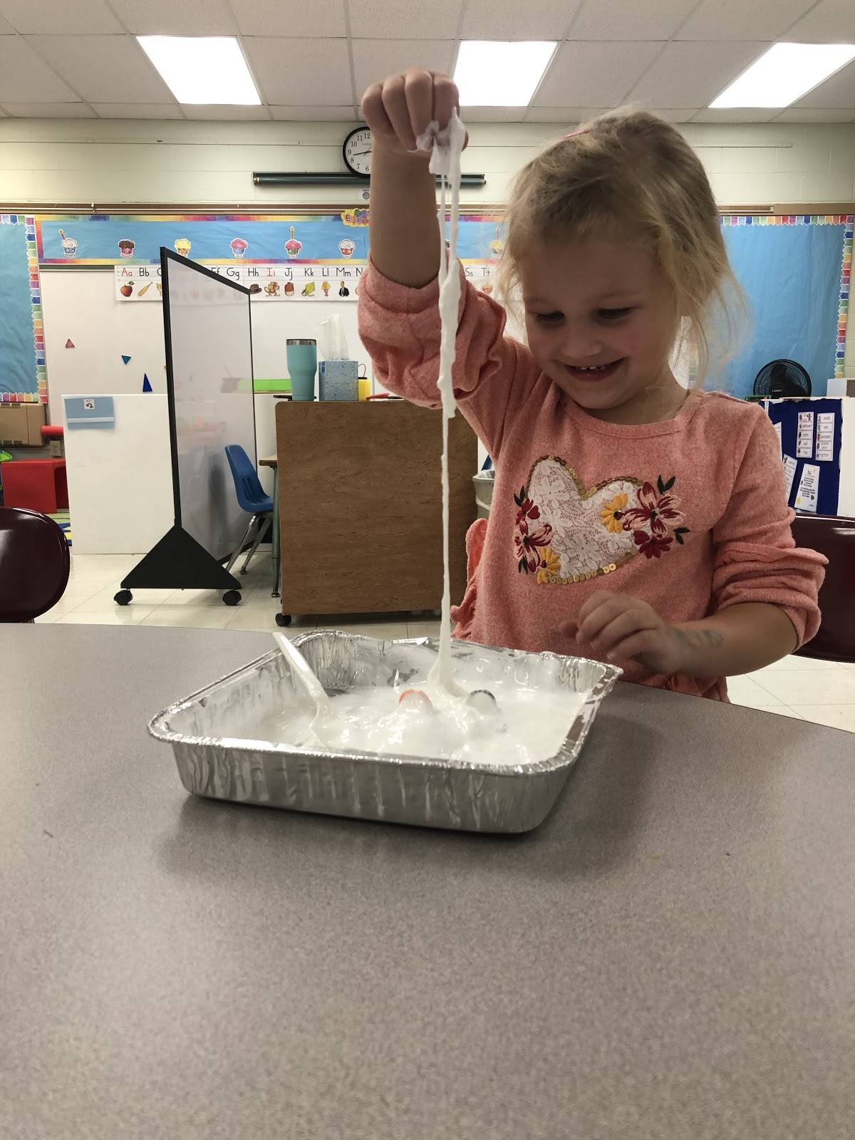 Tiny Toppers student engaged in a sensory activity.