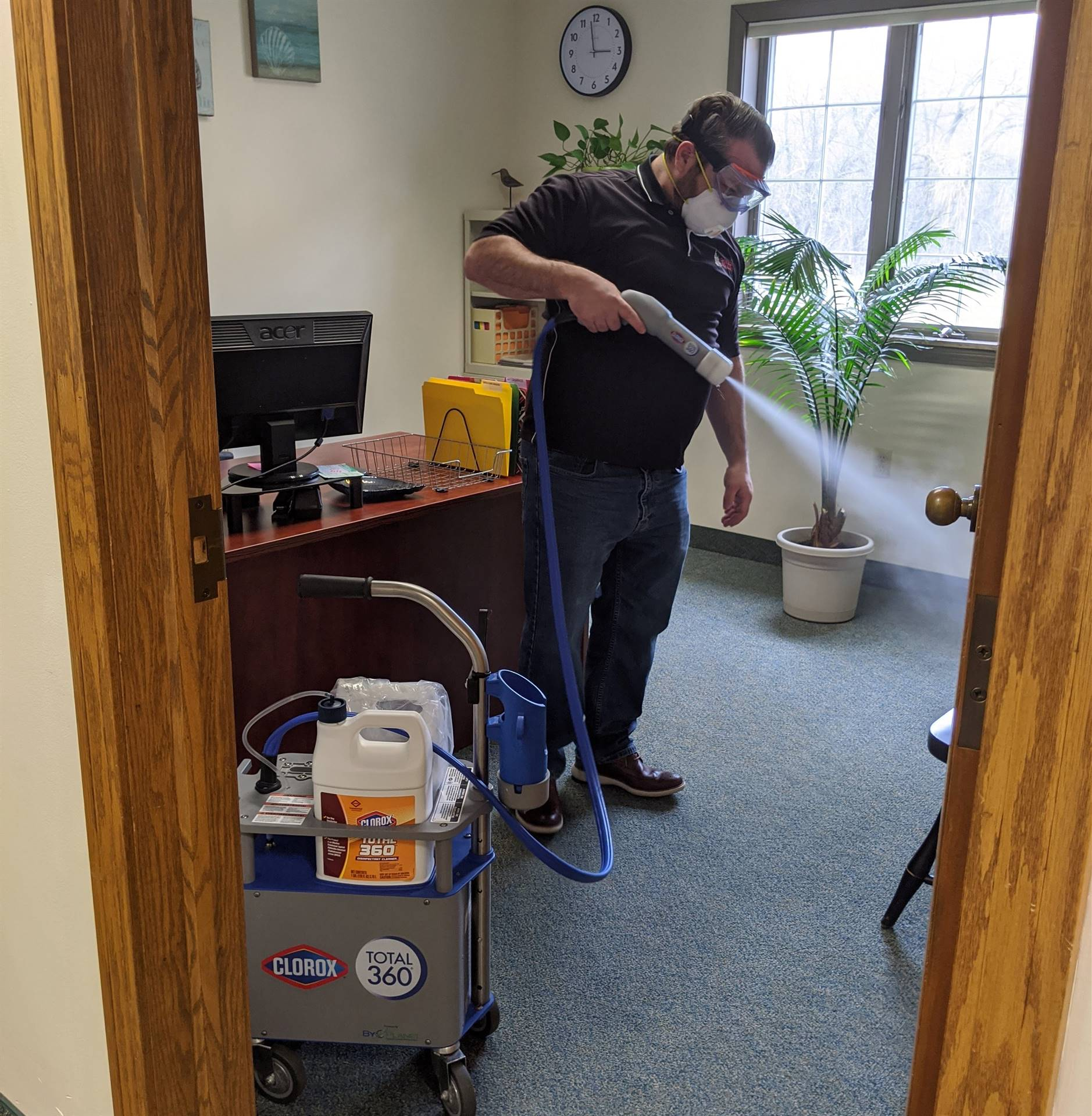 Assistant Superintendent of Business Affairs Steve Kofol using 360 Clorox Disinfecting Machine.