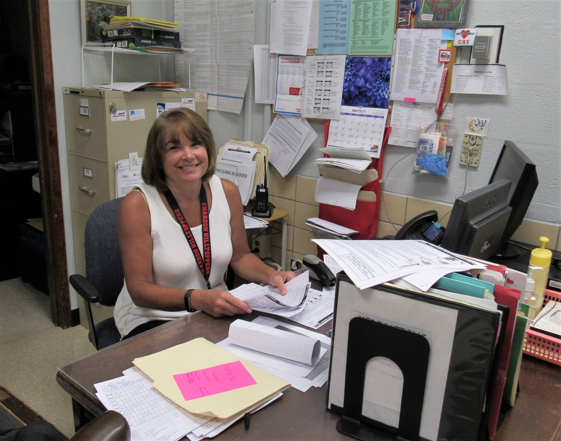 Head School Nurse Jan Hoffmann working at her desk.