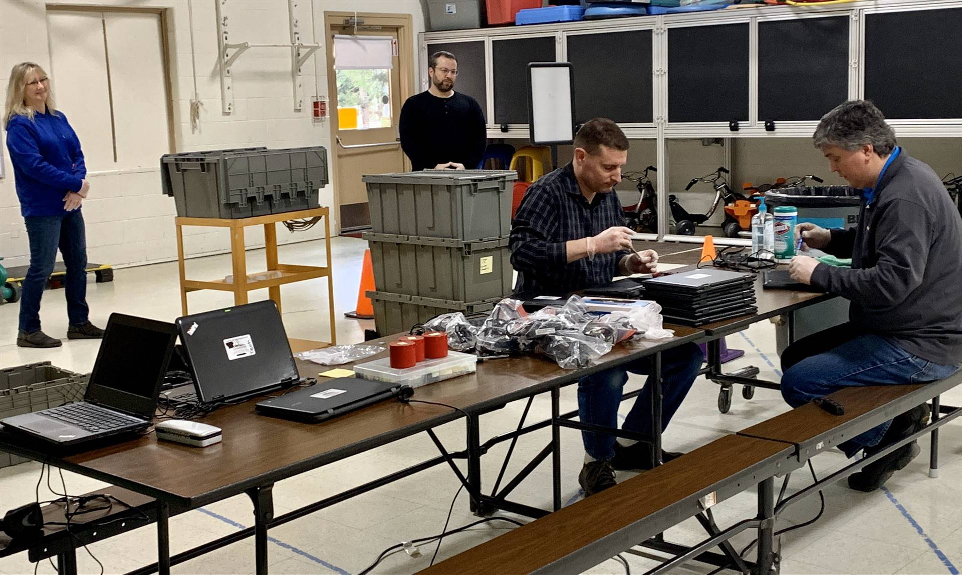 Business Affairs Department working on Chromebook Repairs