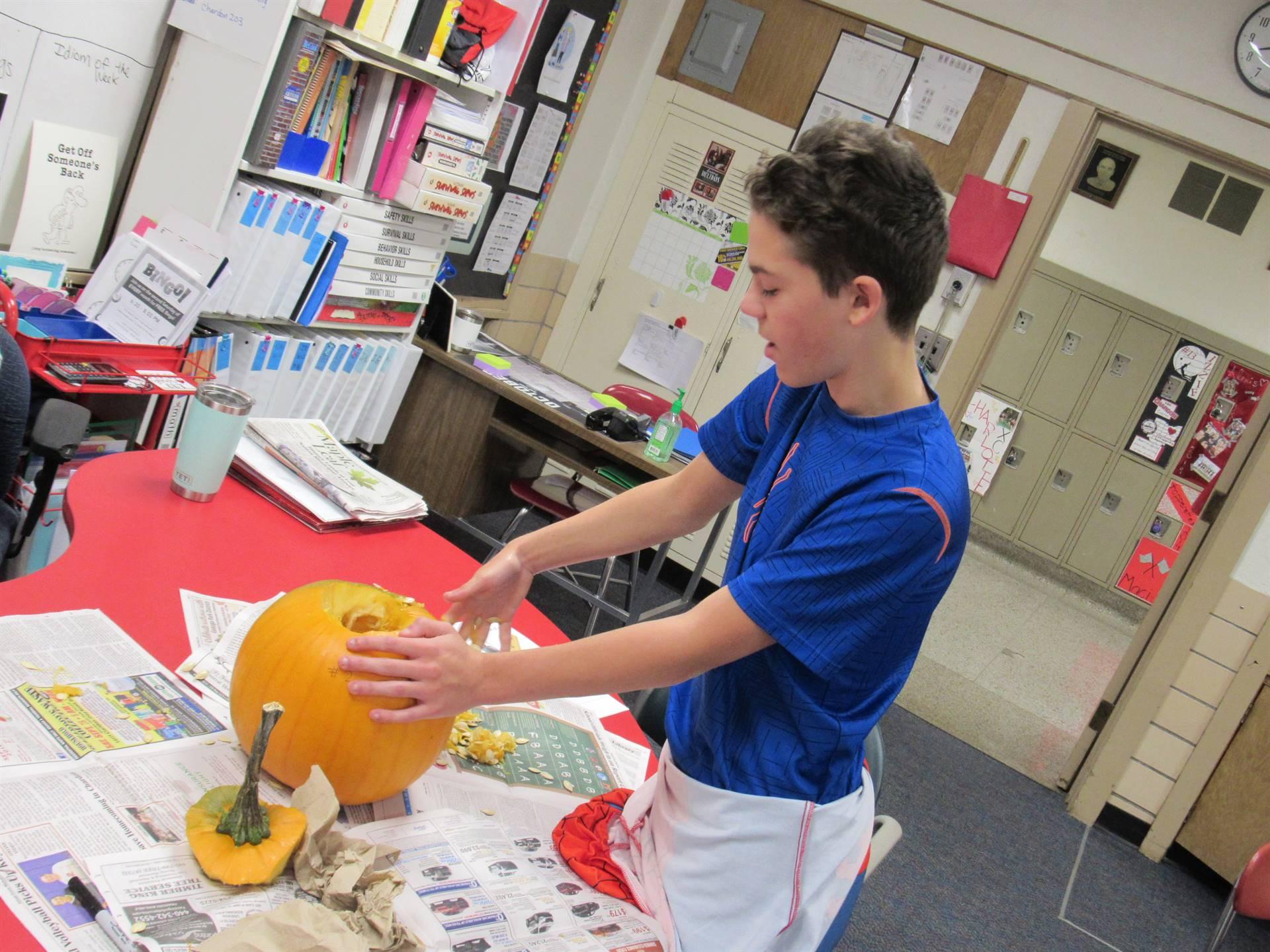 CHS student carving a pumpkin