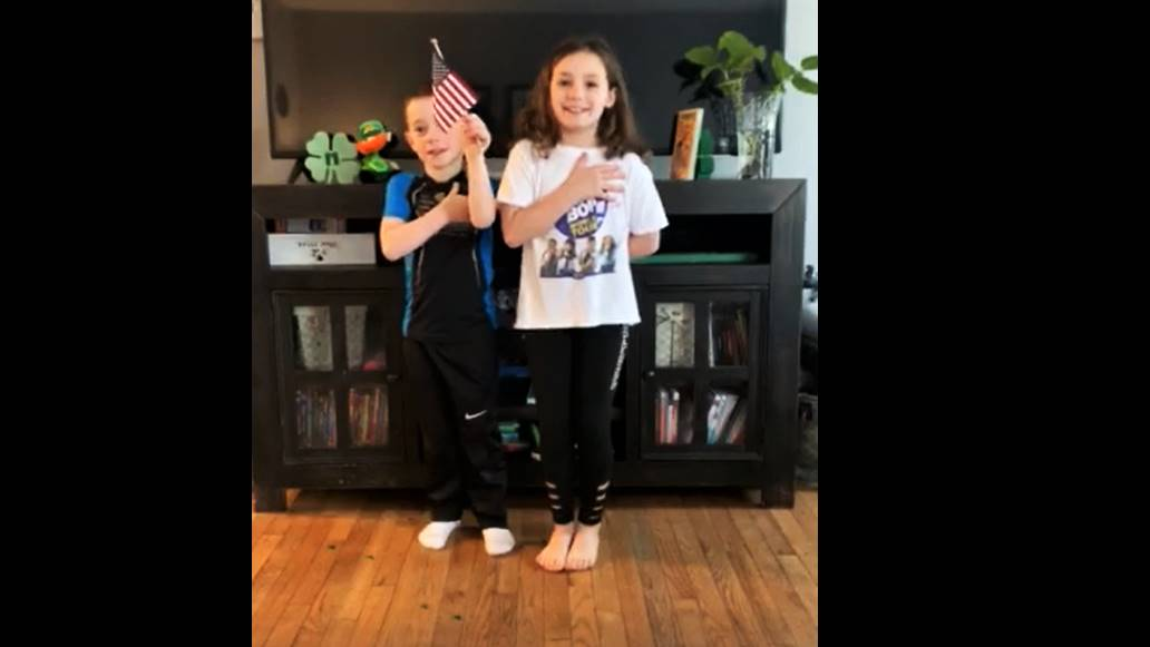 Park Elementary Student and Sibling Reciting Pledge of Allegiance for the District
