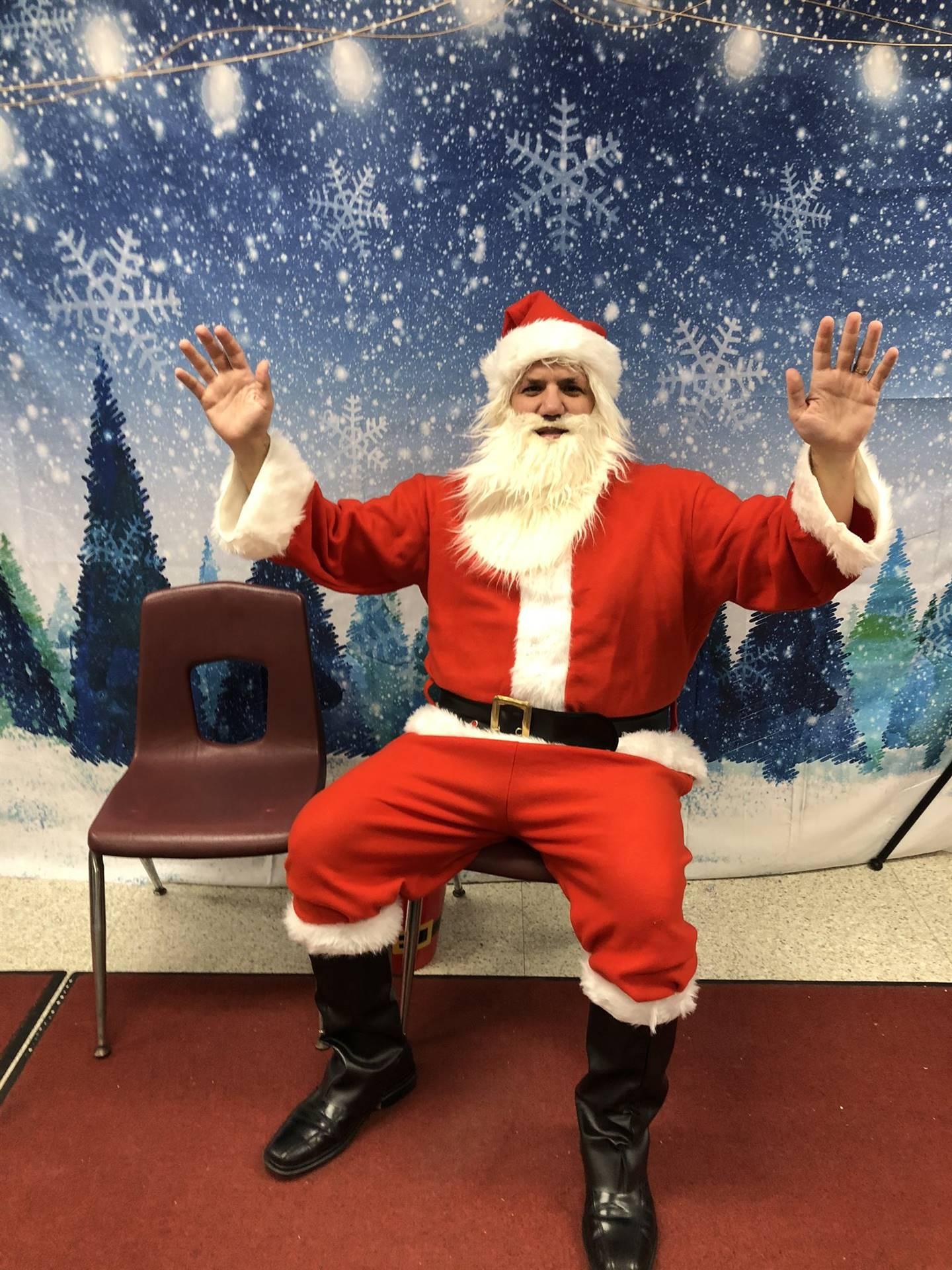 "Photo 11:  Principal Tim Velotta dressed as ""Principal Santa"" for an afterschool event."