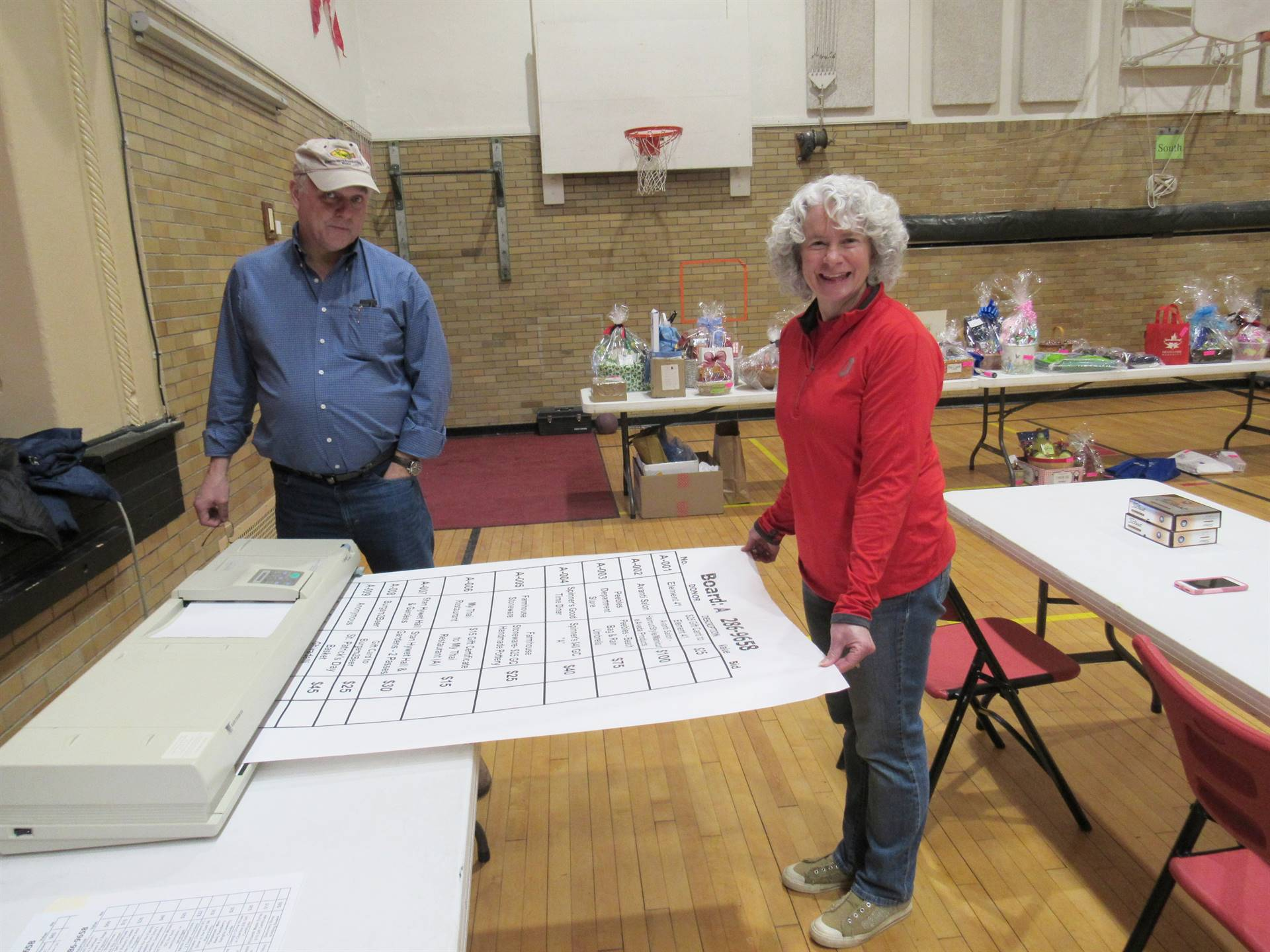 Photo 4:  Chuck Rischar and CoCo Griffis in the Park Elementary School gymnasium preparing for the C