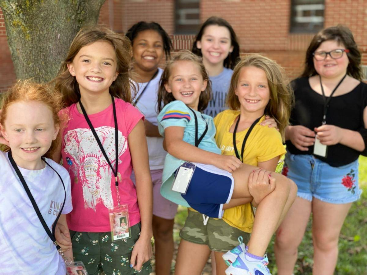 Photo 6:  7 Munson students in a group photo outside at recess - smiling for the camera