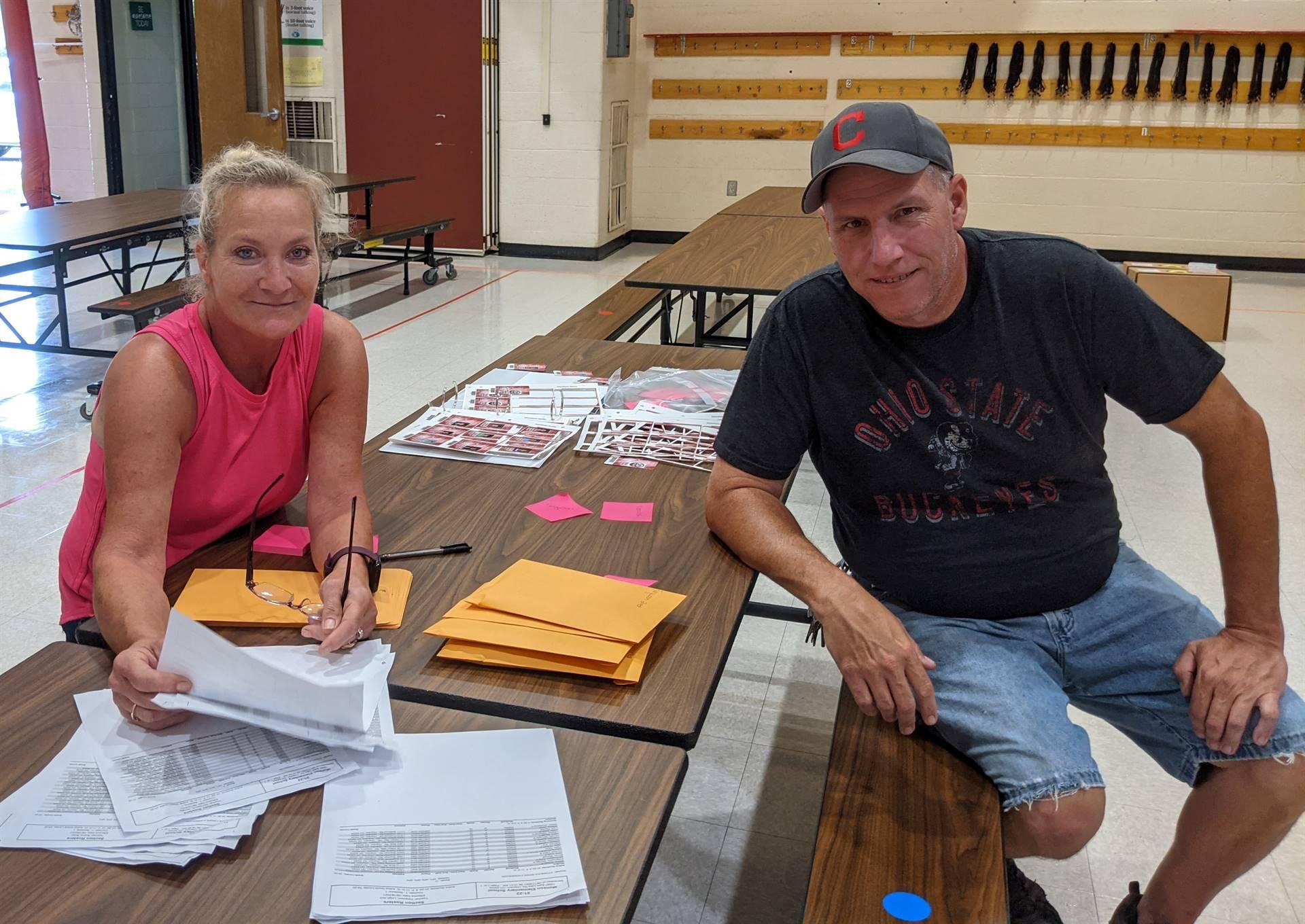 Photo 24:  Munson staff members Molly Thomas (Food Service) and Charles Walsh (Custodial) sitting at