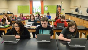 in-classroom photo - students working on Chromebooks